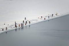 钓鱼在冰的全部人在冬天 图库摄影