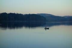 钓鱼在夜间 免版税库存图片