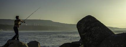钓鱼在日出 库存图片
