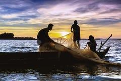 钓鱼在日出 免版税库存照片