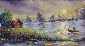 钓鱼在有小船的湖 免版税库存图片
