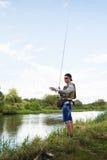 钓鱼在河 免版税库存照片