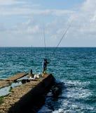 钓鱼在海运 免版税库存图片