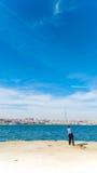 钓鱼在码头里斯本 免版税库存照片