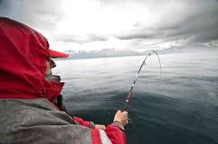 钓鱼多雨 免版税库存照片