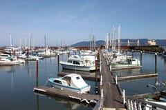 钓鱼海滨广场小的游艇的小船 库存照片