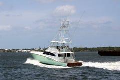 钓鱼百万条游艇的美元 免版税库存照片