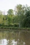 钓鱼的湖,在水的一个爱好夏天 图库摄影
