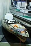 钓鱼的现代皮船在陈列 免版税图库摄影