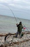 钓鱼者大抓住鱼捕鱼 库存照片