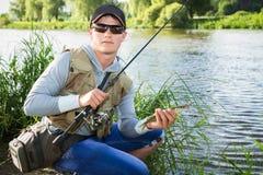 钓鱼转动在一条美丽的河 图库摄影