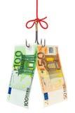 钓鱼钩和货币 库存图片