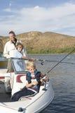 钓鱼从A小船的父亲和儿子 免版税图库摄影