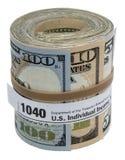 钞票卷1040形式橡皮筋儿隔绝了白色 免版税库存图片