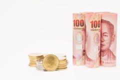 钞票和硬币 免版税库存图片