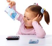 钞票欧元少量女孩少许纸张 图库摄影