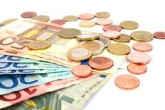 钞票硬币 免版税库存图片