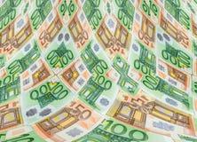 钞票50和100作为背景的欧元特写镜头 库存照片