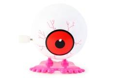 钟表机构眼睛行程桃红色玩具白色 免版税库存照片