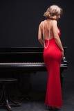 钢琴妇女 库存照片