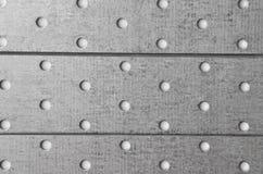 钢穿孔的金属背景 库存图片