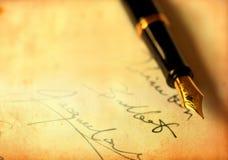钢笔签名 免版税库存照片
