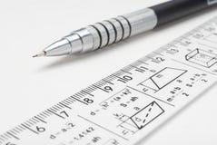 钢铅笔和统治者 免版税图库摄影