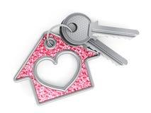 钥匙和房子垂饰 免版税库存图片