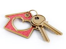 钥匙和房子垂饰 库存图片