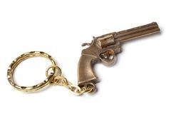 钥匙的小装饰品作为左轮手枪 免版税图库摄影