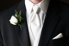 钮扣眼上插的花婚礼 图库摄影