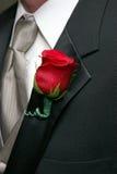 钮扣眼上插的花红色上升了 图库摄影