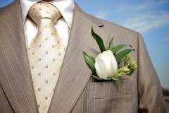 钮扣眼上插的花领带 免版税库存图片