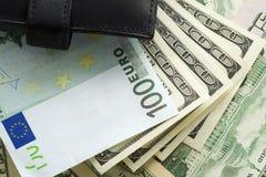 钱包和货币 免版税库存照片