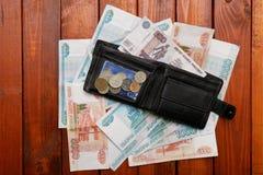 钱包和货币 免版税库存图片