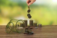 钱币及奖章收集家的概念在瓶的金钱 库存照片