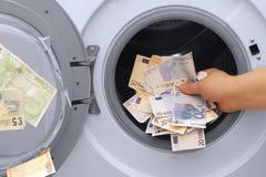洗钱非法现金欧元和磅 免版税图库摄影