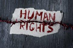 铁丝网和文本人权 免版税库存照片