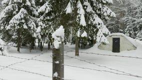 铁丝网围拢的小军事老地堡在冬天森林里 影视素材