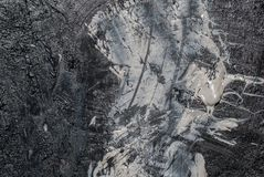 铁表面用白色老油漆的残余和黑颜色,背景纹理报道 库存照片