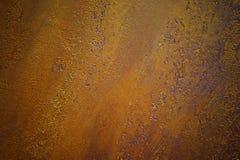 铁锈金属纹理背景金子和紫色 库存照片
