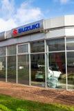 铃木马达在经销权大厦的公司商标 免版税库存图片