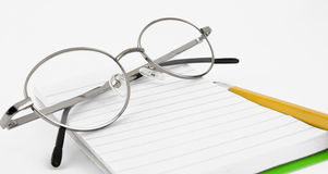 铅笔、在构成的笔记本和玻璃 免版税图库摄影
