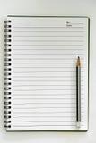 铅笔和在纸笔记 免版税库存照片