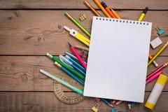 铅笔和笔学生有笔记本的 库存图片