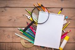 铅笔和笔学生有笔记本的 免版税库存图片