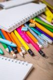 铅笔和笔学生有笔记本的 免版税图库摄影