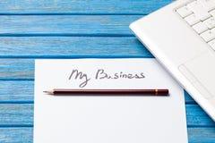 铅笔和纸与我的事务在笔记本附近措辞 免版税图库摄影