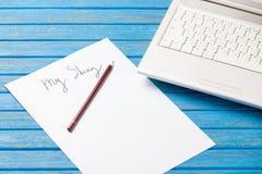 铅笔和纸与我的故事在笔记本附近措辞 图库摄影