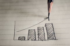 铅笔图在笔记本纸企业概念的企业图表 免版税库存照片